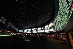 LAS VEGAS, NV - FEBRUARY 02:  The betting line and some of the nearly 400 proposition bets for Super Bowl 50 between the Carolina Panthers and the Denver Broncos are displayed at the Race & Sports SuperBook at the Westgate Las Vegas Resort & Casino on February 2, 2016 in Las Vegas, Nevada. The newly renovated sports book has the world's largest indoor LED video wall with 4,488 square feet of HD video screens measuring 240 feet wide and 20 feet tall.