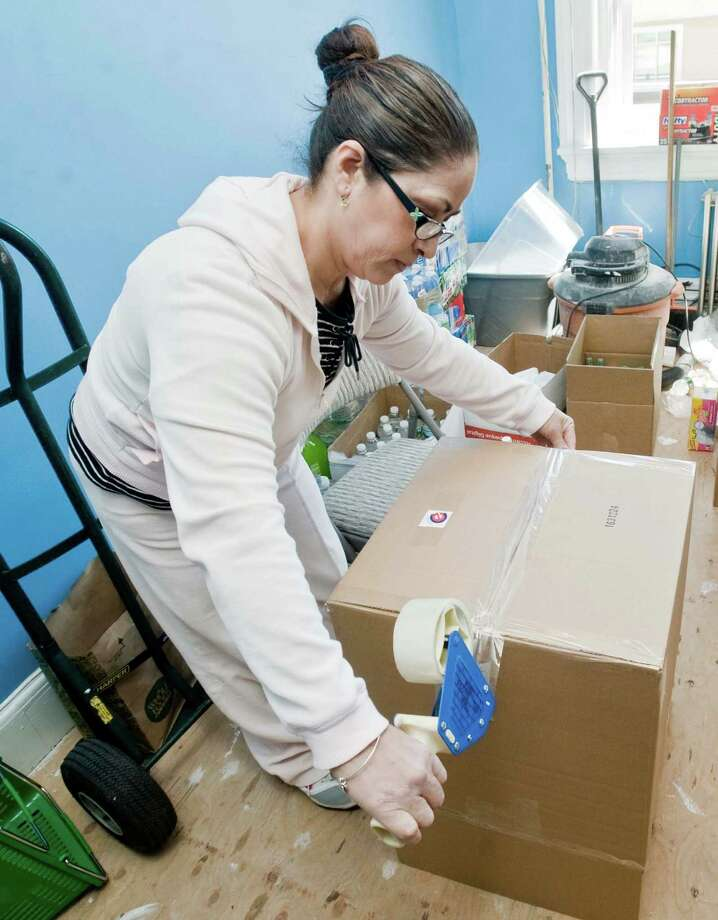 Stephanie Solorzano of Danbury, volunteering at The Ecuadorian Civic Center of Greater Danbury, tapes boxes for donations the Center collected for the victims of the 7.8-magnitude earthquake that struck the South American nation on April 16. Sunday, April 24, 2016 Photo: Scott Mullin / For The / The News-Times Freelance