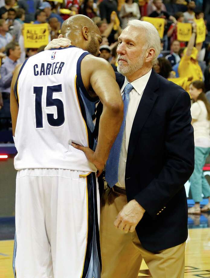 MEMPHIS, TN - APRIL 24: Vince Carter #15 of the Memphis Grizzlies speaks to head coach Gregg Popovich of the San Antonio Spurs after a 116-96 Spurs victory over the Grizzlies in Game Four of the First Round of the NBA Playoffs at FedExForum on April 24, 2016 in Memphis, Tennessee. NOTE TO USER: User expressly acknowledges and agrees that, by downloading and or using this photograph, User is consenting to the terms and conditions of the Getty Images License Agreement. Photo: Frederick Breedon, Getty Images / 2016 Getty Images