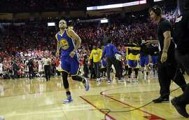 Golden State Warriors' Stephen Curry jogs off the court at the end of the first half in Game 4 of a first-round NBA basketball playoff series, Sunday against the Houston Rockets, April 24, 2016, in Houston. (AP Photo/David J. Phillip)