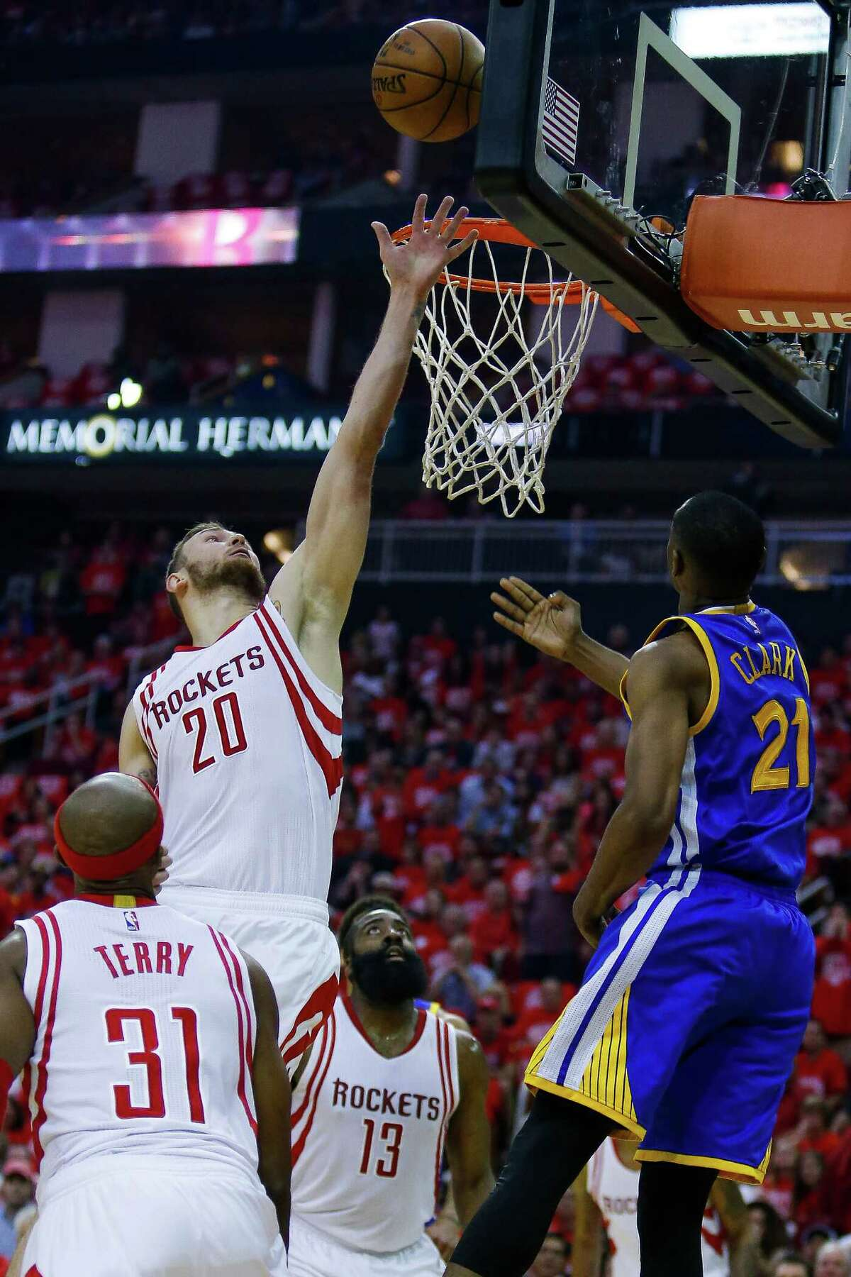 Houston Rockets forward Donatas Motiejunas (20) denies a shot to Golden State Warriors guard Ian Clark (21) during the first half in game four of a first-round NBA Playoffs series at Toyota Center Sunday, April 24, 2016 in Houston.