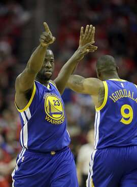 Golden State Warriors' Draymond Green, left, celebrates with teammate Andre Iguodala during the second half in Game 4 of a first-round NBA basketball playoff series against the Houston Rockets, Sunday, April 24, 2016, in Houston. (AP Photo/David J. Phillip)