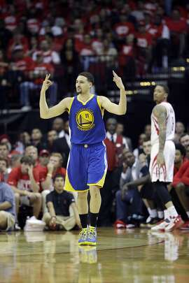 Golden State Warriors' Klay Thompson celebrates after hitting a 3-point basket during the second half in Game 4 of a first-round NBA basketball playoff series against the Houston Rockets, Sunday, April 24, 2016, in Houston. (AP Photo/David J. Phillip)