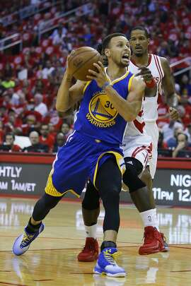Golden State Warriors guard Stephen Curry (30) drives to the basket during the first half in game four of a first-round NBA Playoffs series at Toyota Center Sunday, April 24, 2016 in Houston. ( Michael Ciaglo / Houston Chronicle )