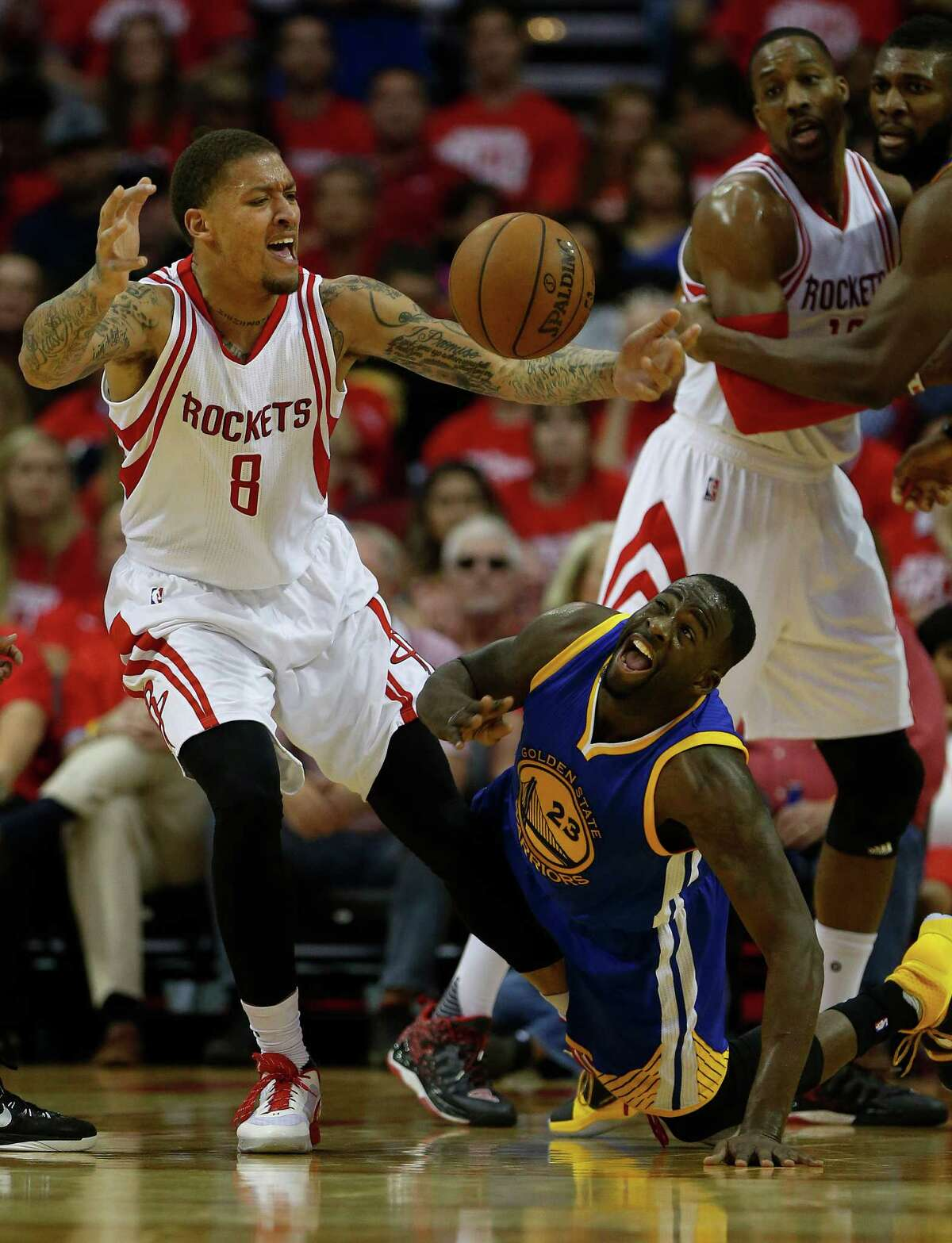 Houston Rockets forward Michael Beasley (8) battles for a loose ball with Golden State Warriors forward Draymond Green (23) during the second half of game four of the first round of the NBA playoff series at Toyota Center, Sunday, April 24, 2016, in Houston.