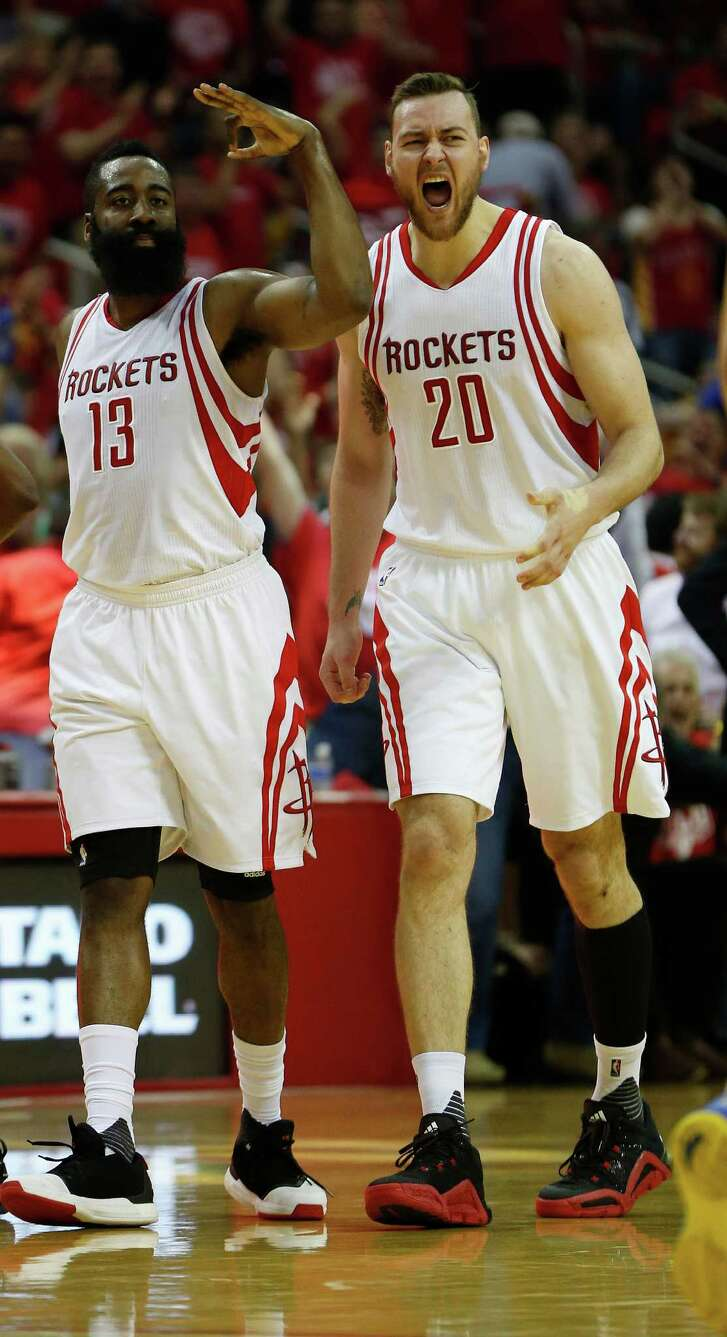 Houston Rockets guard James Harden (13) and Donatas Motiejunas (20) react to Harden's three-pointer during the first half of game four of the first round of the NBA playoff series at Toyota Center, Sunday, April 24, 2016, in Houston.