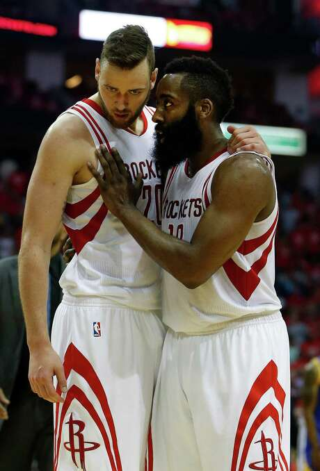 Houston Rockets forward Donatas Motiejunas (20) and guard James Harden (13) talk at the end of the first half of game four of the first round of the NBA playoff series at Toyota Center, Sunday, April 24, 2016, in Houston. Photo: Karen Warren, Houston Chronicle / © 2016 Houston Chronicle