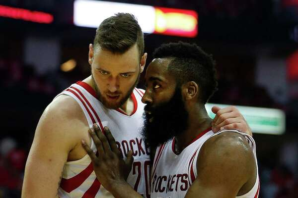Houston Rockets forward Donatas Motiejunas (20) and guard James Harden (13) talk at the end of the first half of game four of the first round of the NBA playoff series at Toyota Center, Sunday, April 24, 2016, in Houston.