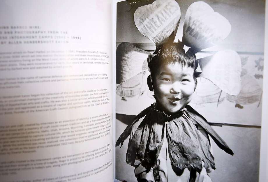 """Bob Kaneko first saw this childhood photo of himself in the book """"Beauty Behind Barbed Wire: The Arts of the Japanese in our War Relocation Camps."""" Photo: Kathleen Duncan"""