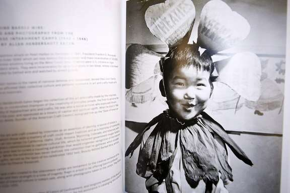 A photo of Robert Kaneko, 78, that he first saw in the book Beauty behind barbed wire: The arts of the Japanese in our war relocation camps at his home in Berkeley, California. Despite it being of him, he does not recall the image and only stumbled upon it when a family member found it in research on the internment camps.