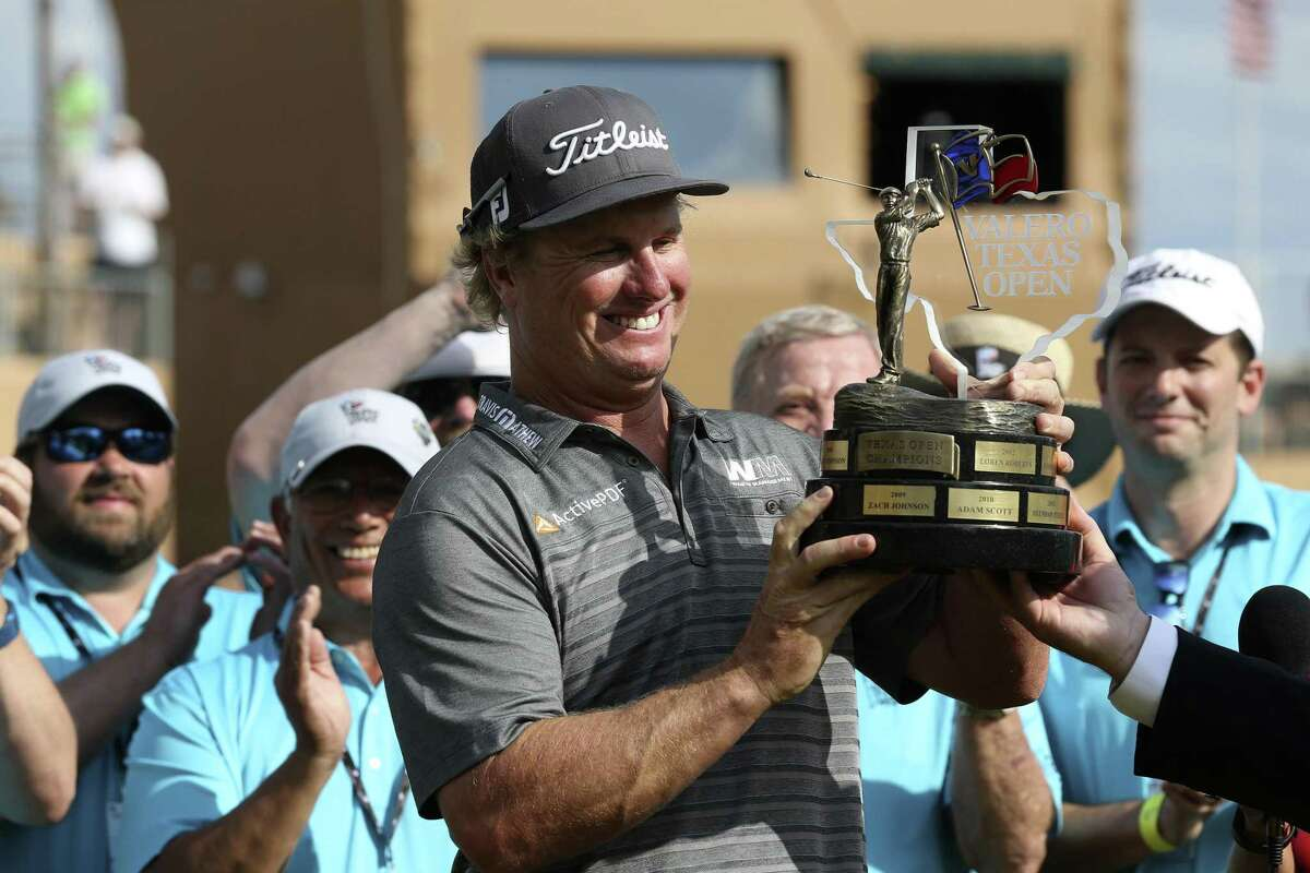 Charley Hoffman holds the Valero Texas Open trophy after winning the tournament with a 12-under-par at TPC San Antonio on April 24, 2016.