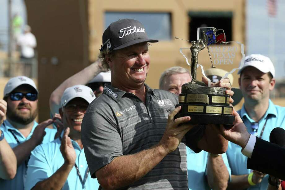Charley Hoffman holds the Valero Texas Open trophy after winning the tournament with a 12-under-par at TPC San Antonio on April 24, 2016. Photo: Jerry Lara /San Antonio Express-News / © 2016 San Antonio Express-News