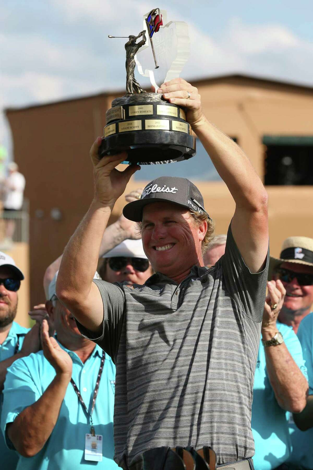 Charley Hoffman, of Las Vegas, Nevada, holds the Valero Texas Open trophy after winning the tournament with a 12-under-par at TPC San Antonio, Sunday, April 24, 2016. Hoffman birdied the 18th hole to win the tournament. Patrick Reed, of Houston, came in second at11-under-par and at third was Chad Collins, of Cloverdale, Indiana at 10-under-par.