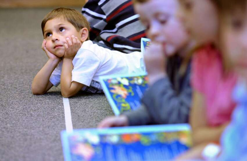 Four-year-old Luke Zielinski, of Weston, listens to Kathie Lee Gifford sing along to her new children's book