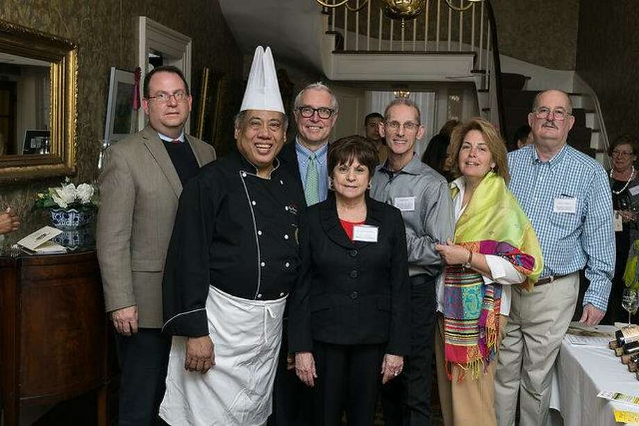 The International Center's 3rd Annual TASTES of the World was held at the historic Pruyn House on April 7th and included 12 area chefs and producers including Chef Yono (2nd from left) (Diane Conroy-LaCivita)