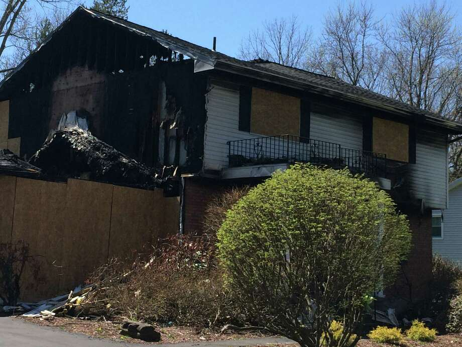 The home of Colonie police officer Israel Roman and his wife Deborah on Schalren Drive as seen on April 24, 2016. In Feb. 2016, police said Roman shot and killed his wife and 10-year-old son before setting his house on fire and killing himself. The house still sits as it did that February day, with a posting from the Town of Colonie saying it is an unsafe condition. (Lauren Stanforth/Times Union)