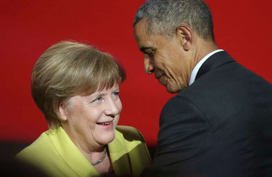US President Barack Obama (R) and German Chancellor Angela Merkel attend the official opening ceremony of the Hanover industry Fair at the Hannover Congress Center HCC in Hanover, on April 24, 2016. USA is partner country of the industrial fair Hannover Messe 2016 running from April 25 to April 29.  / AFP PHOTO / RONNY HARTMANNRONNY HARTMANN/AFP/Getty Images Photo: RONNY HARTMANN / AFP