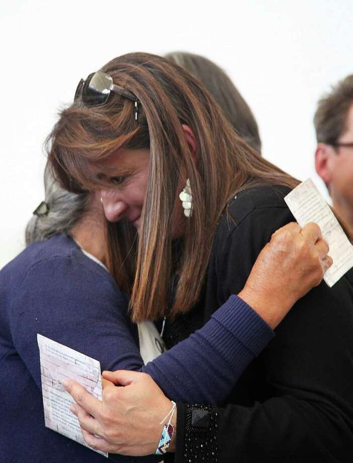 Angela Buitrago of the international experts group, left, hugs a relative of the 43 missing students, in Mexico City, Sunday, April 24, 2016. In a report released Sunday, the group said there is evidence that Mexican police tortured some of the key suspects arrested in the disappearance of the students. The 43 students have not been heard from since they were taken by local police in September 2014 in the city of Iguala, Guerrero state. (AP Photo/Marco Ugarte) ORG XMIT: MXMU108 Photo: Marco Ugarte / AP