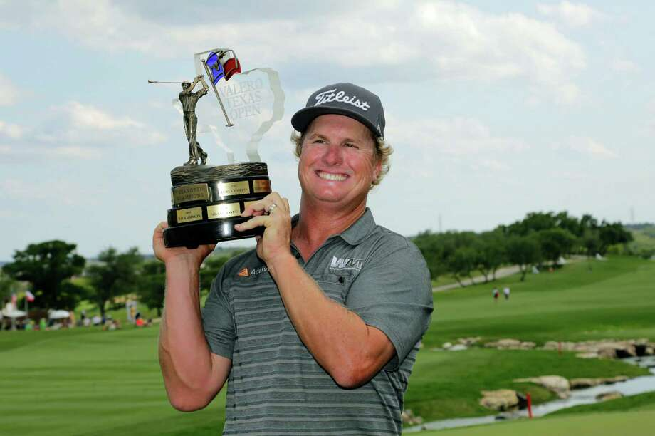 Charley Hoffman poses with his trophy after winning the Texas Open golf tournament, Sunday, April 24, 2016, in San Antonio. (AP Photo/Eric Gay) ORG XMIT: TXEG115 Photo: Eric Gay / Copyright 2016 The Associated Press. All rights reserved. This m