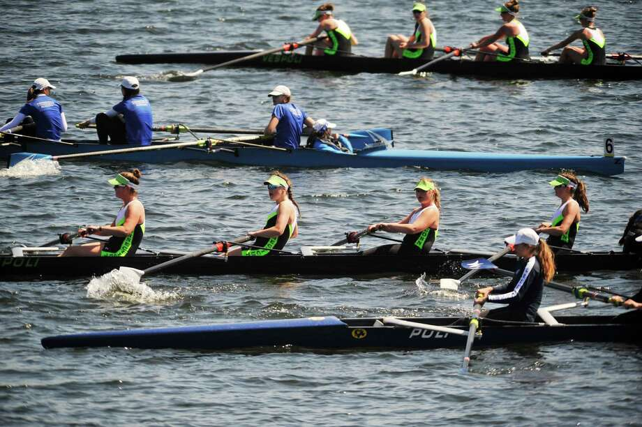 Girl's high school rowing teams make their way back to the dock after competing at the 19th annual Saratoga Invitational Regatta on Sunday, April 24, 2016, in Saratoga Springs, N.Y.  (Paul Buckowski / Times Union) Photo: PAUL BUCKOWSKI / 10036307A