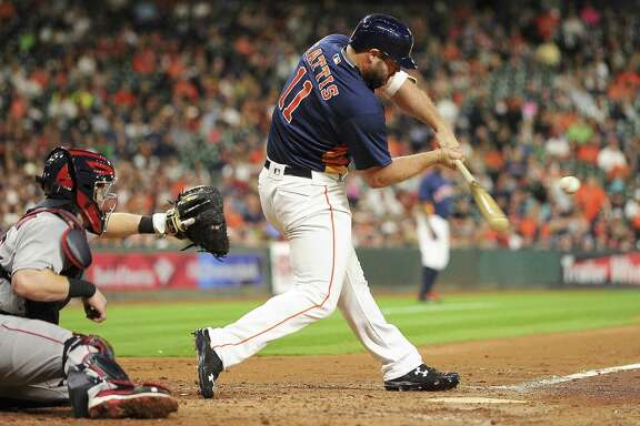 HOUSTON, TX - APRIL 24: Evan Gattis #11 of the Houston Astros hits an RBI single during the third inning against the Boston Red Sox at Minute Maid Park on April 24, 2016 in Houston, Texas.