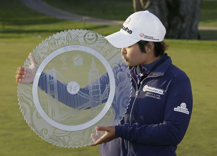 Haru Nomura, of Japan, kisses her trophy on the 18th green of the Lake Merced Golf Club after winning the Swinging Skirts LPGA Classic golf tournament Sunday, April 24, 2016, in Daly City, Calif. Nomura closed with a 1-over 73 in wind gusting to 35 mph at Lake Merced to finish at 9-under 279 and beat South Africa's Lee-Anne Pace by four strokes. (AP Photo/Eric Risberg)