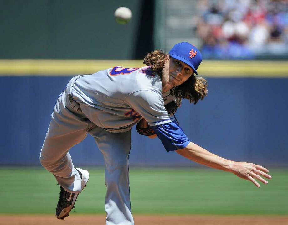 New York Mets' Jacob deGrom pitches against the Atlanta Braves during the first inning of a baseball game, Sunday, April 24, 2016, in Atlanta. (AP Photo/John Amis)  ORG XMIT: GAJA101 Photo: John Amis / FR69715 AP