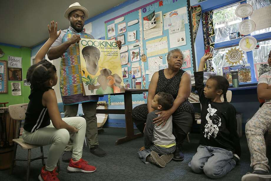 Chef Bryant Terry (middle) talks with students at Meadows Livingstone elementary school in S.F. about food health. School Principal Gail Meadows is at right. Photo: Liz Hafalia, The Chronicle