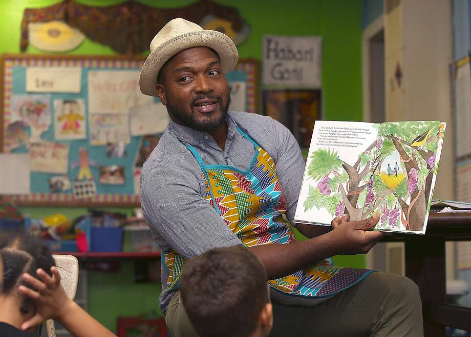 Chef Bryant Terry reads a book about food to the students of Meadows Livingstone elementary school in S.F. Photo: Liz Hafalia, The Chronicle