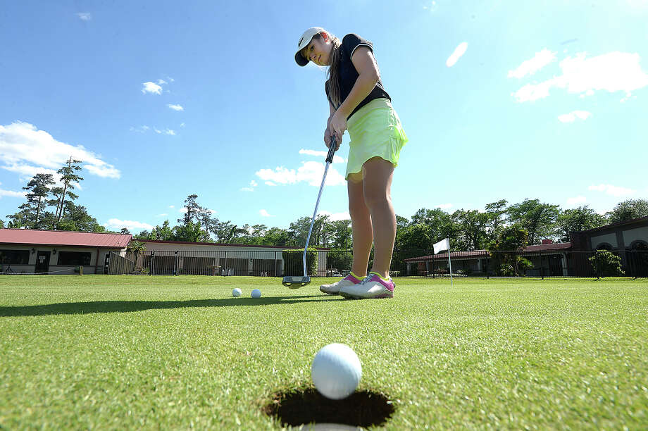 Little Cypress-Mauriceville's Lauren Cox putts on the green as she and teammates get in a final practice at Sunset Grove Country Club before Monday's state tournament game in Austin. This will be the second year Cox will compete at the state level, where she is favorited to win the state title. Photo taken Friday, April 22, 2016 Kim Brent/The Enterprise Photo: Kim Brent / Beaumont Enterprise