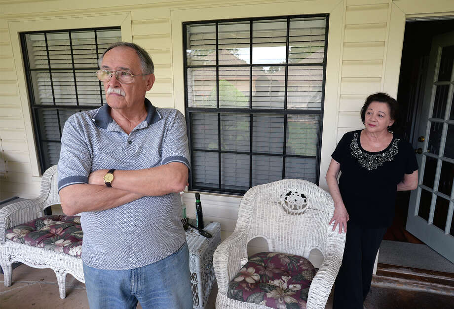 Ron Cunningham and Nancy Cunningham talk about a recent burglary that happened at their west end home. The Cunninghams said they feel the burglar watched as they pack their car for a vacation then broke in after they drove away.  Photo taken Friday, April 15, 2015 Guiseppe Barranco/The Enterprise Photo: Guiseppe Barranco, Photo Editor