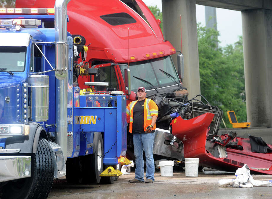 An accident involving two tractor trailers closed down Interstate 10 near 11th Street Monday morning. Traffic was temporarily diverted at Walden Road and Fannett Road while crews removed rocks flung onto the road from one of the trucks.  Photo taken Monday, April 25, 2016 Guiseppe Barranco/The Enterprise Photo: Guiseppe Barranco, Photo Editor