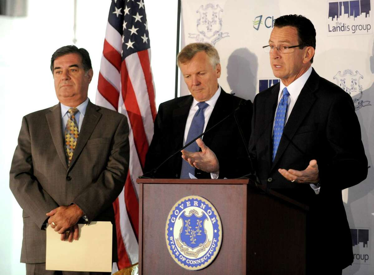 Charter Communications CEO Tom Rutledge, center, listens to Gov. Dannel P. Malloy in October 2012 alongside then-Mayor Mike Pavia at what would become the company's headquarters at 400 Atlantic Street in Stamford, Conn.