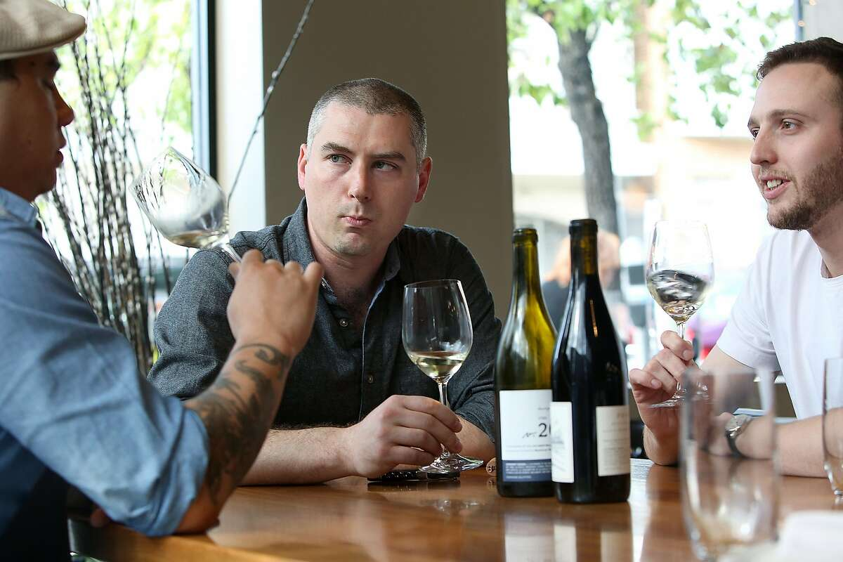 Gianpaolo Paterlini (middle), the wine director at both Acquerello and 1760 restaurants, tastes wine with bar manager Christopher Longoria (left) and sommelier David Roby (right) at 1760 in San Francisco, California on thursday, april 21, 2016.