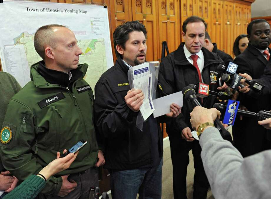 From left, Commissioner of the New York State Department of Environmental Conservation Basil Seggos, Director of State Operations Jim Malatras and Commissioner of Health for New York State Dr. Howard Zucker explain how the state is flushing the Hoosick Falls water and installing filters for PFOA on Friday, Feb. 26, 2016 in Hoosick Falls, N.Y. (Lori Van Buren / Times Union) Photo: Lori Van Buren / 10035607A