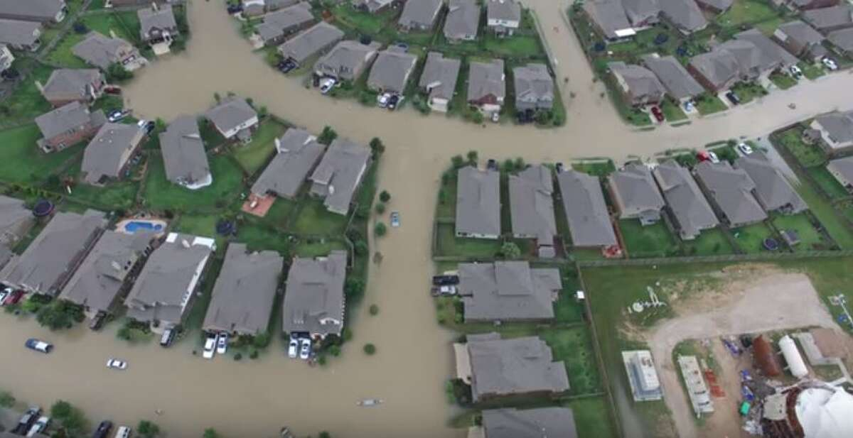 Texas Guardsmen use a drone to survey the severe flooding in the western Harris County town of Brookshire in late April 2016.