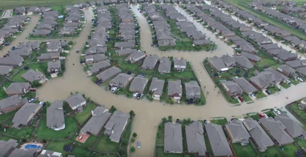 15. Tax Day Flood (continued) Texas Guardsmen use a drone to survey the severe flooding in the western Harris County town of Brookshire in late April 2016.