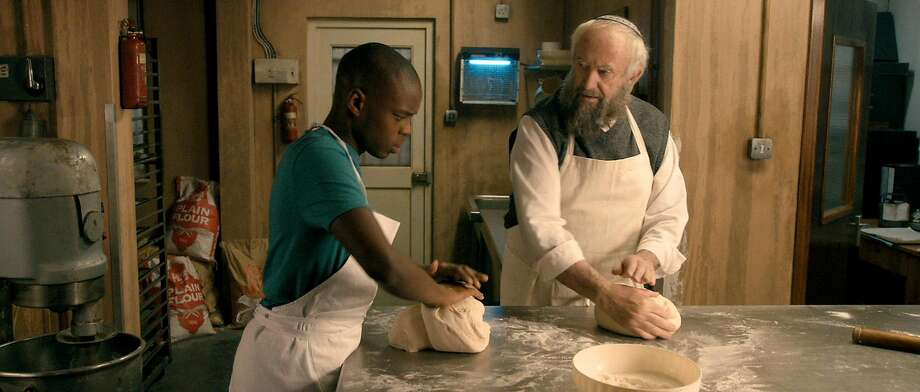 "Muslim youth Ayyash (Jerome Holder, left) is hired by Jewish bakery shop owner Nat (Jonathan Pryce) in ""Dough."" Photo: Menemsha Films"