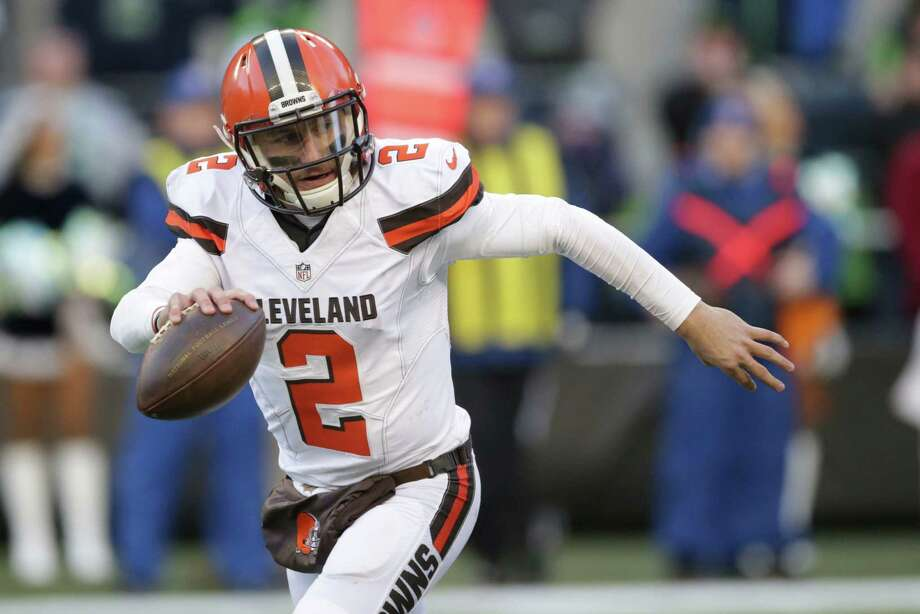 In this Sunday, Dec. 20, 2015 file photo, Cleveland Browns quarterback Johnny Manziel looks to pass against the Seattle Seahawks in the second half of an NFL football game in Seattle. Johnny Manziel's agent, Drew Rosenhaus, has told the troubled quarterback to seek help or he will no longer represent him. Photo: Scott Eklund /Associated Press / FR171040 AP