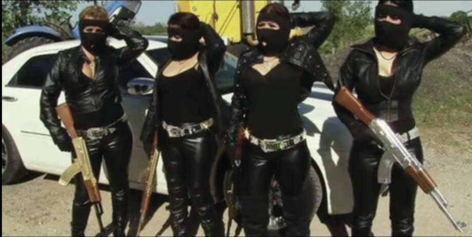 The Mexican outlet El Blog del Narco has published photos purportedly showing women associated with drug cartels posing — some masked, others in various states of undress — with assault rifles, tigers, liquor and trucks. Photo: Courtesy/El Blog Del Narco