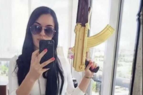 The Mexican outlet El Blog del Narco has published photos purportedly showing women associated with drug cartels posing — some masked, others in various states of undress — with assault rifles, tigers, liquor and trucks.