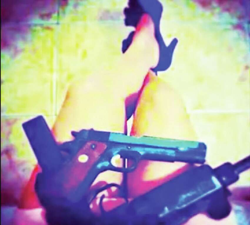 Click ahead to see photos of heavily armed assassins of Mexican cartels.