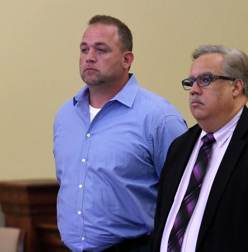 Kevin Rogers, left, stands in Judge Young's courtroom at the Rensselaer County Courthouse for his appearance Friday morning Oct. 9, 2015 in Troy, N.Y. With Rogers is his attorney Gaspar Castillo. (Skip Dickstein/Times Union)