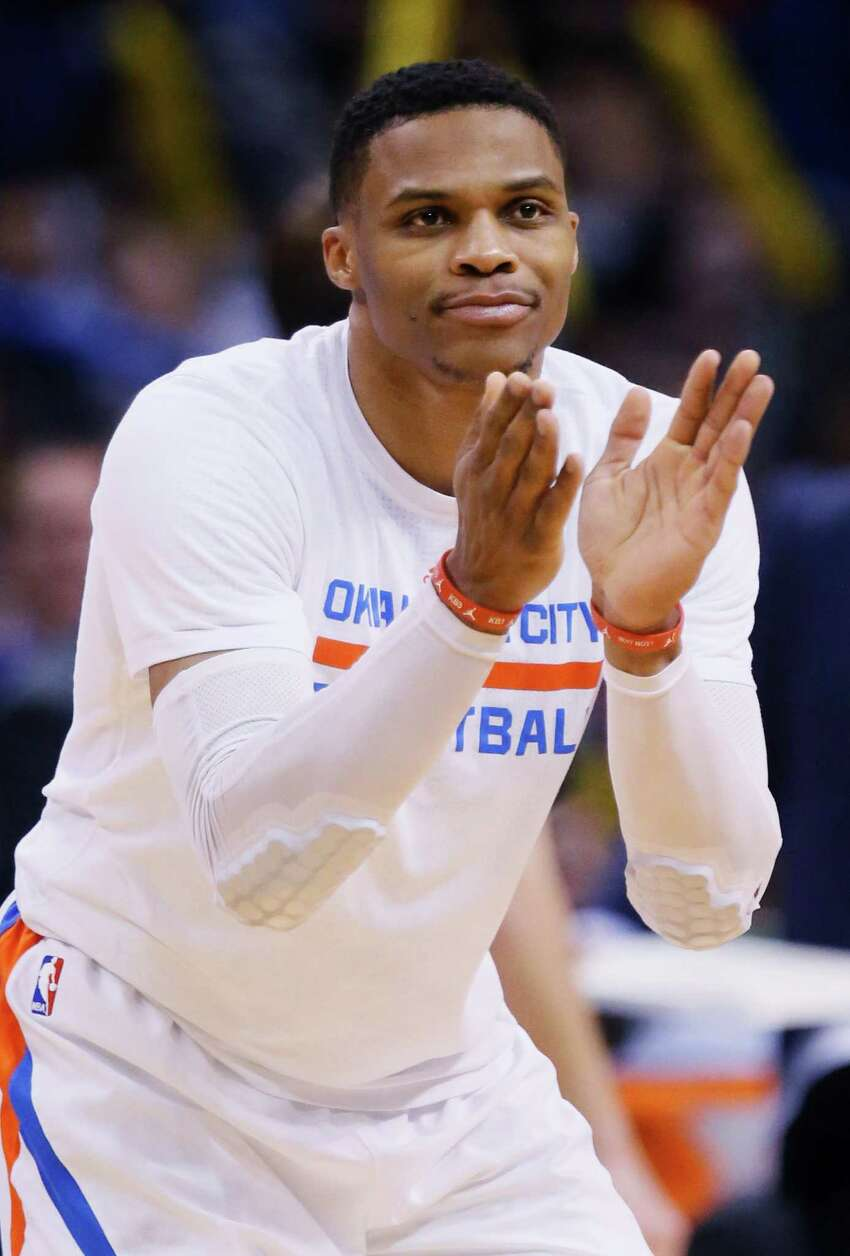 Oklahoma City Thunder guard Russell Westbrook applauds a teammate in the fourth quarter of an NBA basketball game against the Dallas Mavericks in Oklahoma City, Thursday, Jan. 26, 2017. Oklahoma City won 109-98. (AP Photo/Sue Ogrocki)