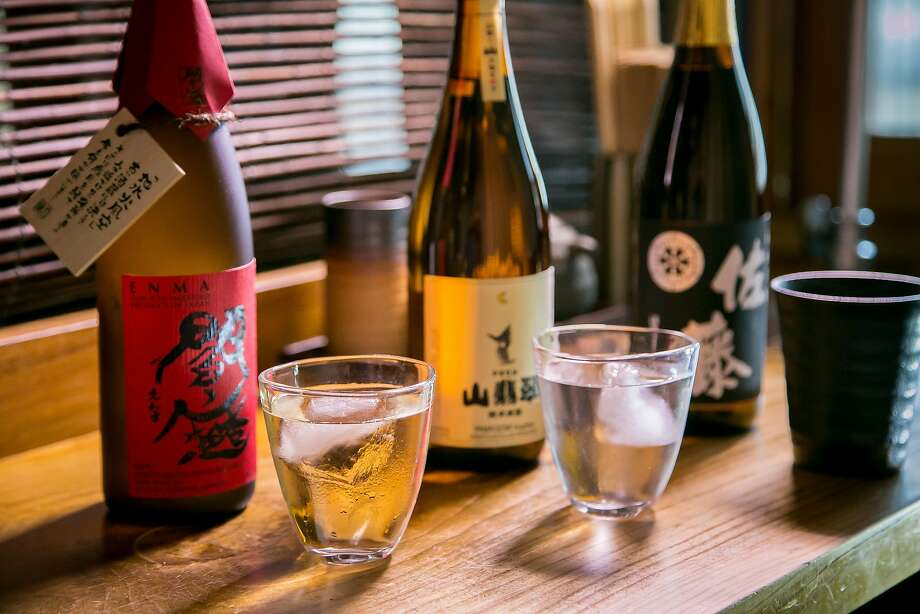Enma shochu (left), made with barley; sato shochu, made with sweet potato; and yamasemi shochu, made with rice at Ippuku in Berkeley. Photo: John Storey, Special To The Chronicle