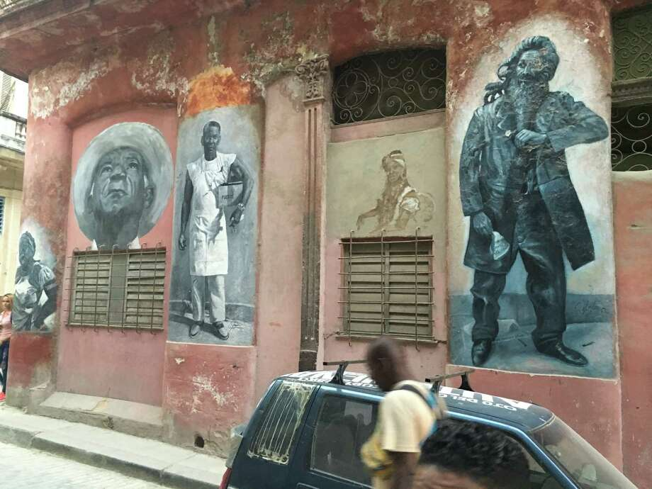 Calle Obispo, a busy shopping area of Havana Vieja, boasts these portraits.  Photo: Madalyn Mendoza