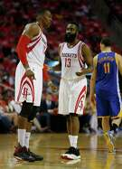 Houston Rockets center Dwight Howard (12) and guard James Harden (13) talk during the first half of game four of the first round of the NBA playoff series at Toyota Center, Sunday, April 24, 2016, in Houston. ( Karen Warren  / Houston Chronicle )