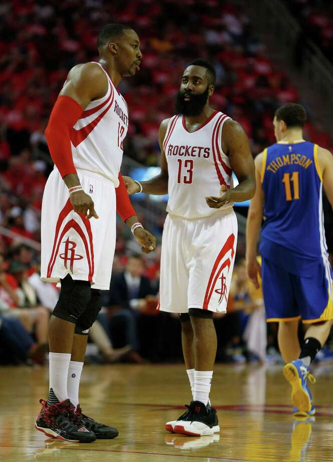 Houston Rockets center Dwight Howard (12) and guard James Harden (13) talk during the first half of game four of the first round of the NBA playoff series at Toyota Center, Sunday, April 24, 2016, in Houston. ( Karen Warren  / Houston Chronicle ) Photo: Karen Warren, Staff / © 2016 Houston Chronicle