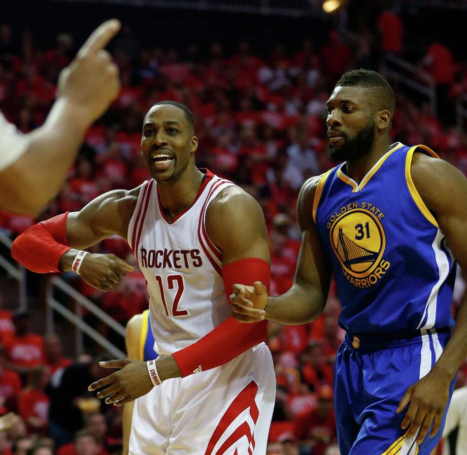Houston Rockets center Dwight Howard (12) reacts after a foul called on him against Golden State Warriors center Festus Ezeli (31) during the first half of game four of the first round of the NBA playoff series at Toyota Center, Sunday, April 24, 2016, in Houston. ( Karen Warren  / Houston Chronicle ) Photo: Karen Warren, Staff / © 2016 Houston Chronicle