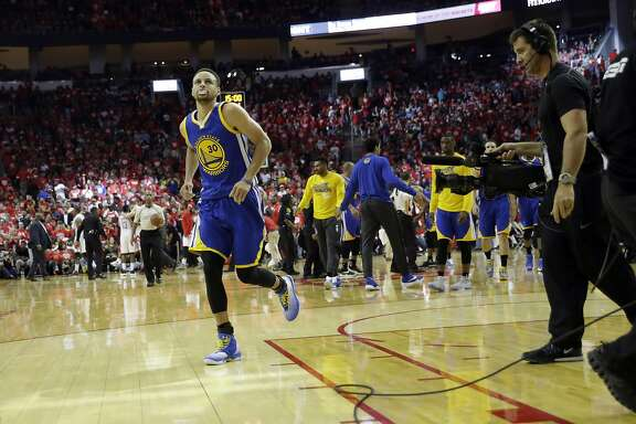 Golden State Warriors' Stephen Curry heads off the court at the end of the first half in Game 4 of a first-round NBA basketball playoff series, Sunday against the Houston Rockets, April 24, 2016, in Houston. (AP Photo/David J. Phillip)